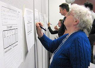 Dotmocracy sheets are filled-in by participants at a Toronto pedestrian conference by Yvonne Bambrick