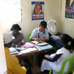 Two doctors seeing two patients in PEPFAR clinic photo by MikeBlyth on Flickr