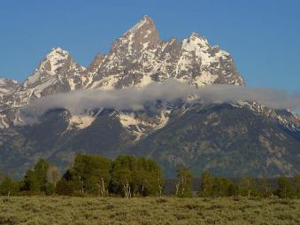 Grand tetons peaks in the morning by Jon Sullivan